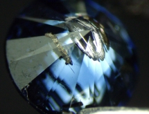 Metallic inclusions and color zoning in blue synthetic diamond