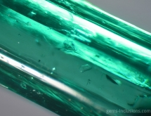 Calcite inclusions in emerald