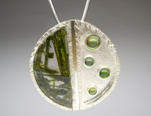 Quartz with epidote inclusions and green tourmalines