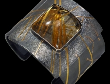 Cuff bracelet with rutilated quartz and 22k gold fused on argentium silver, by Wolfgang Vaatz.