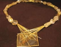 Gold necklace with rutilated quartz