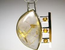 White gold pendant with rutilated quartz