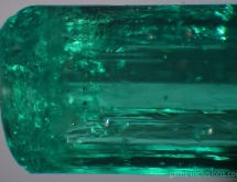 Calcite and pyrite inclusions in emerald