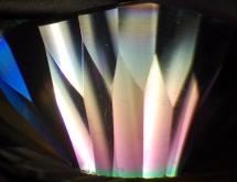 Iridiscent coating film on quartz