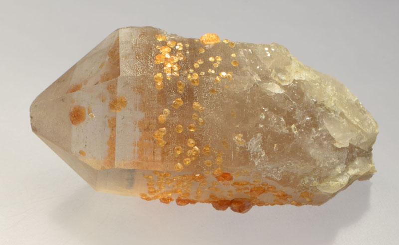 Spessartine in quartz rough
